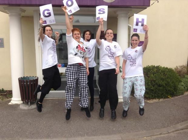 Jumping to it – staff at the Thorpe Bay Premier Inn celebrate their fundraising success