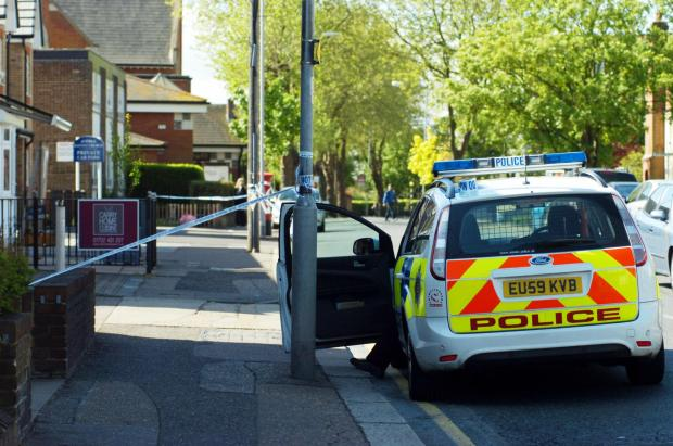Police cordon off street in gun probe