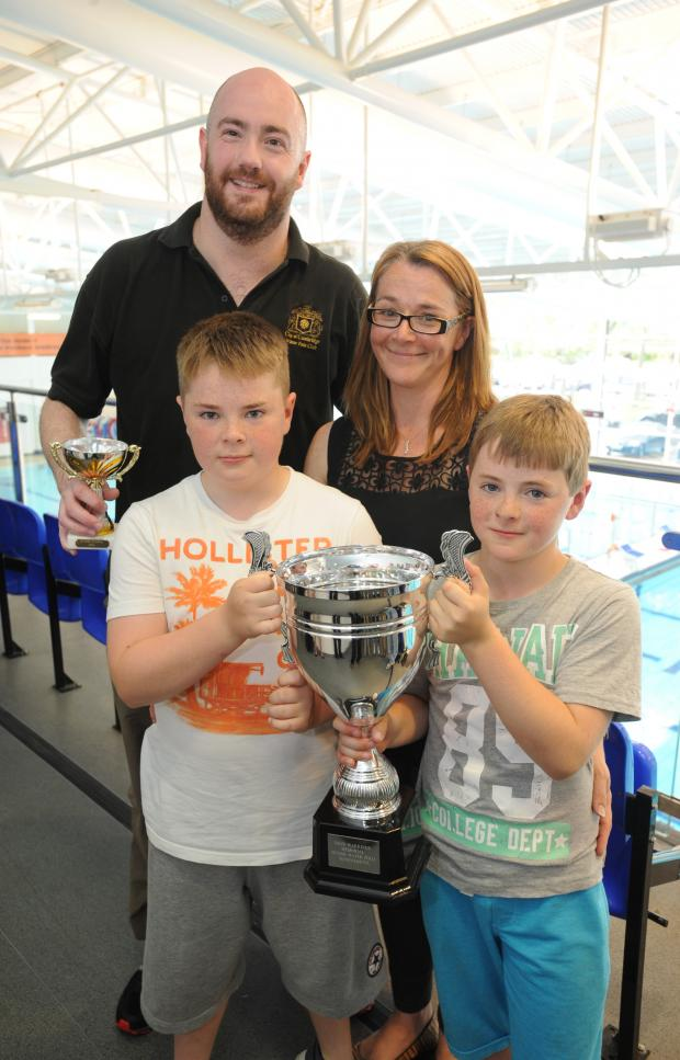 Southend Standard: Remembering Dave - Allstarts captain Nick Ludford with Jane, Oscar, 13, and Patrick, 11