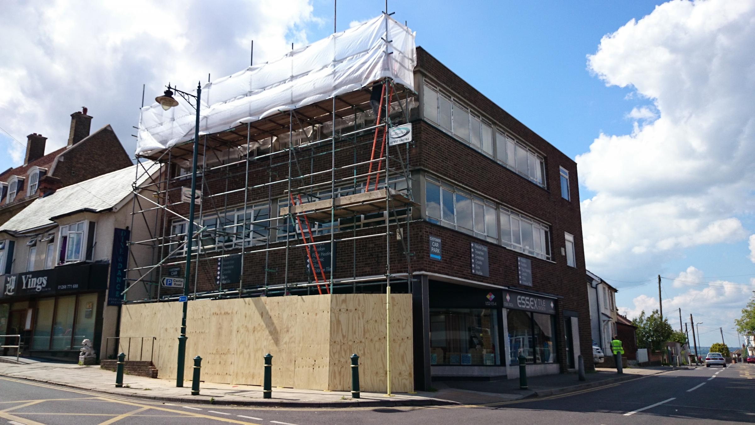 Scaffolding and boarding has been put up outside the building in Rayleigh High Street to make it safe. Pic: Al Underwood