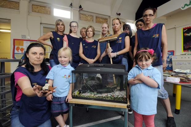 Wrecked – Staff and children with the damaged fish tank