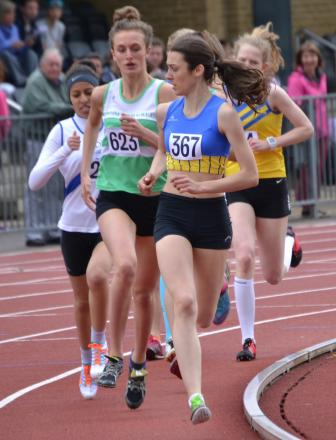 Eventual champion Isobel Ives leads a heat in the under-17 women's 800m