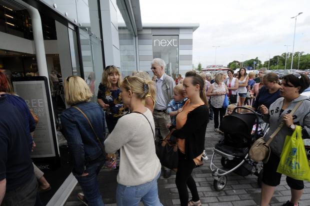 Piling in – shoppers keen to get in as the shop opens