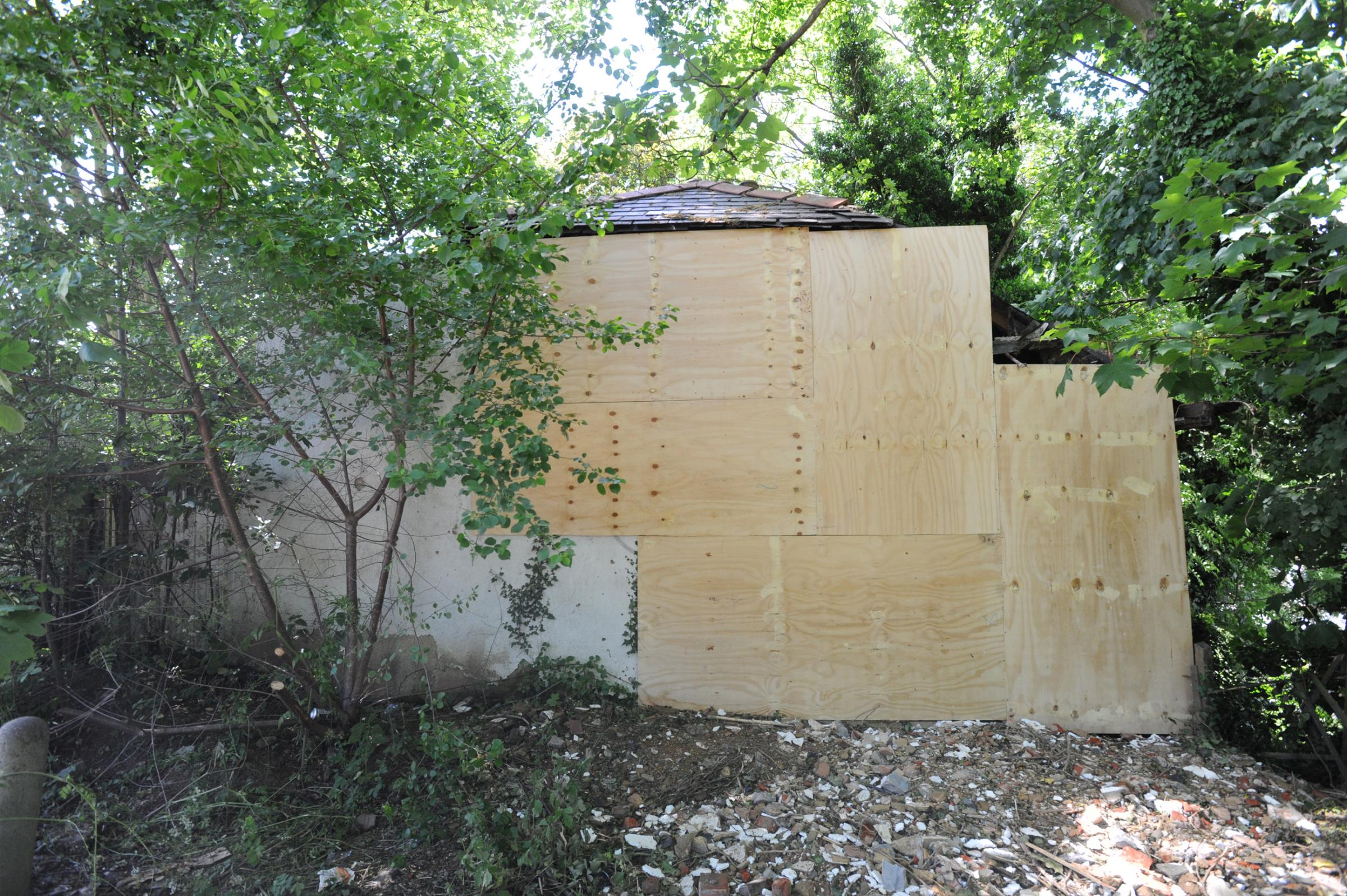Boarded up – the bungalow that was hit by a speeding car