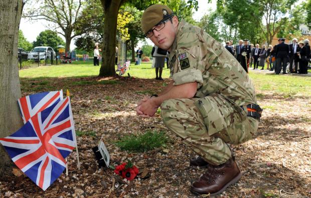 Lance Cpl Holland, from the 1st Battalion, the Royal Anglian Regiment, at the memorial in Wickford