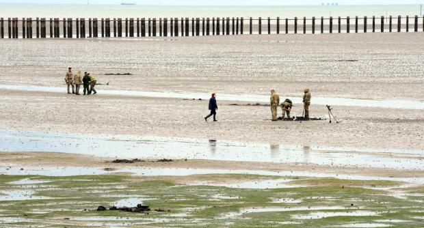 Risk assessment – Royal Navy experts survey Shoebury East Beach after weapons find