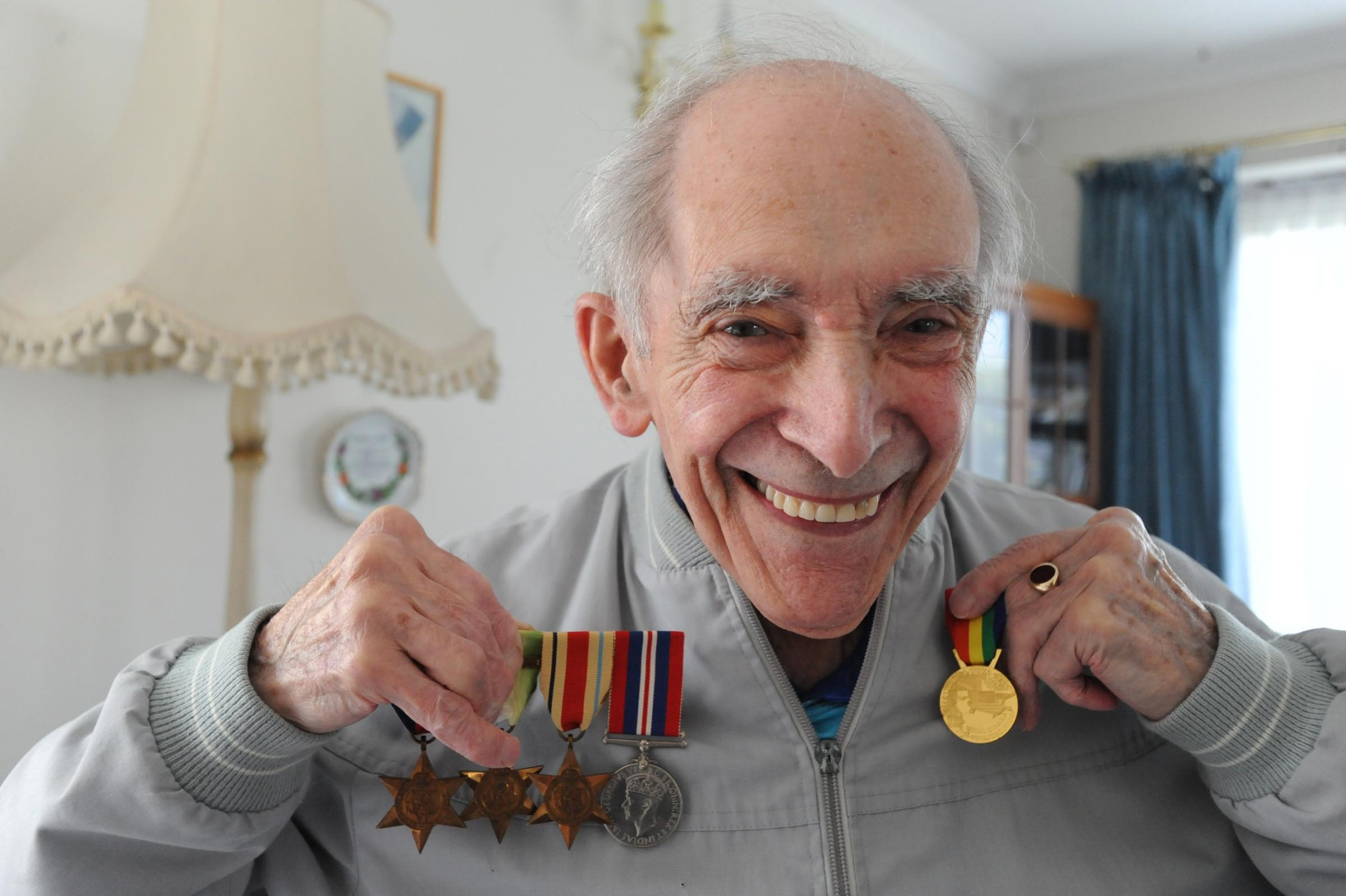Charles Holden with his Second World War medals and his father's medals during the First World War