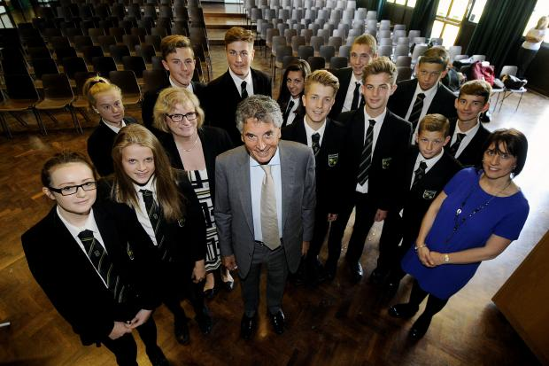 Talk sport – former Arsenal chief David Dein with pupils and staff
