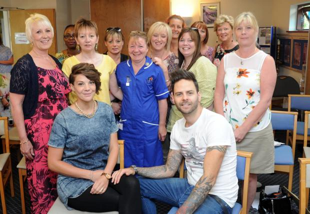 Welcome donation – 5ive's Scott Robinson and wife, Kerry, with St Luke's Hospice staff