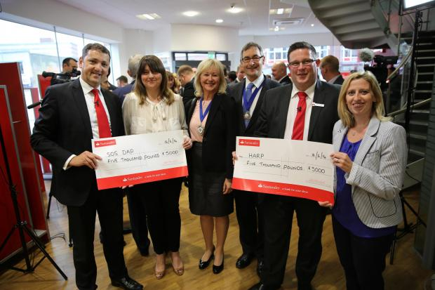 Cheque mates - Martin Bishoff, a representative of the Dove Project, Deputy Mayor Andrew Moring and his wife Louise, Darren Grenfell, Santander Southend branch manager, and a Harp representative