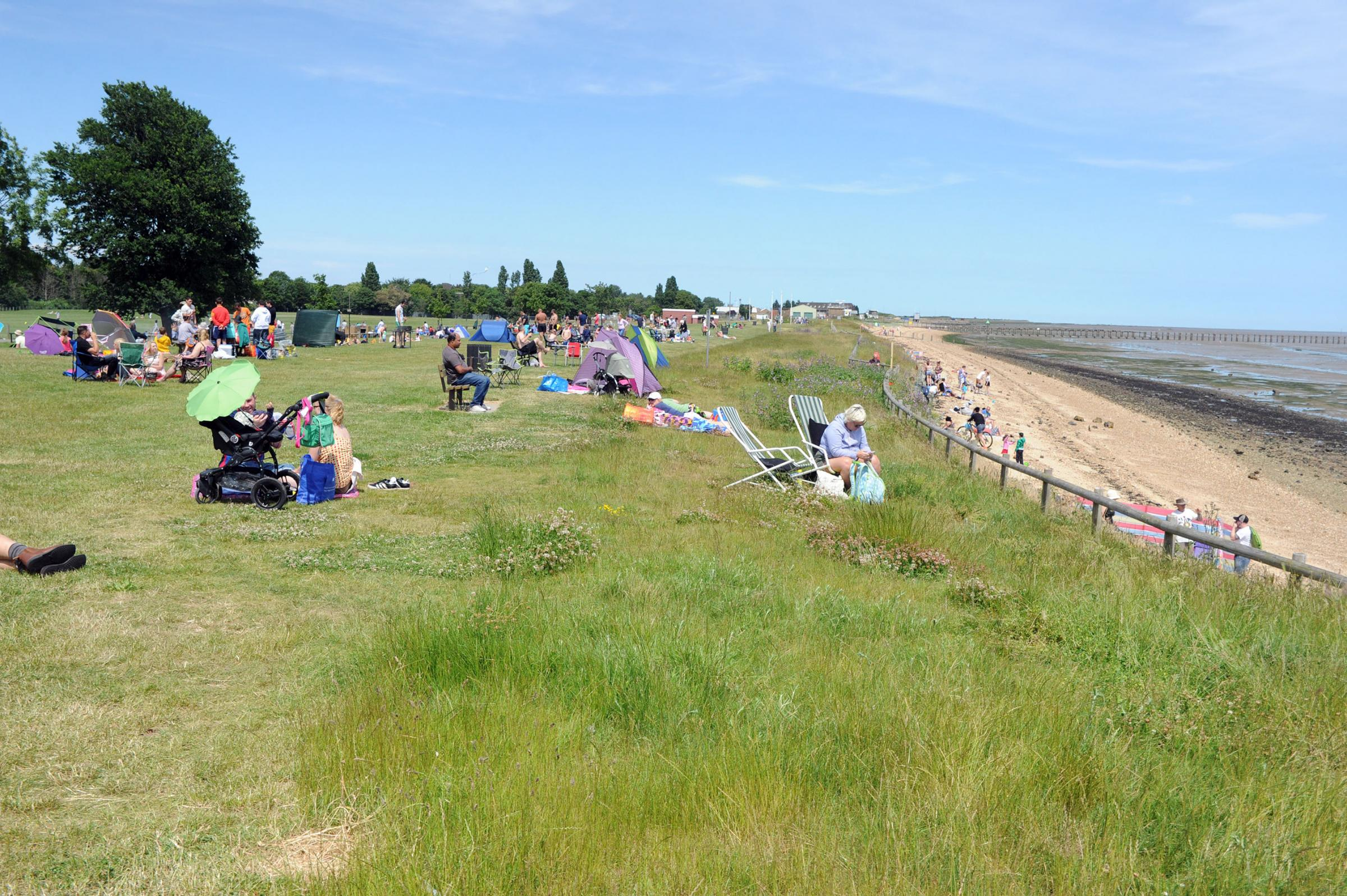 Back in the sun - visitors at East Beach, Shoebury