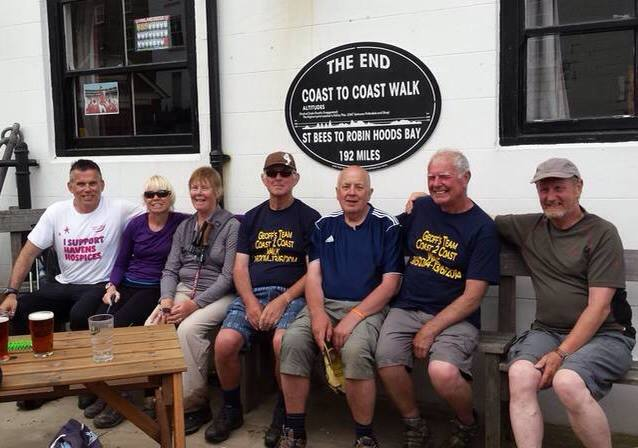 We've don it! The team celebrate after completing the Wainwright Walk to raise money for Havens