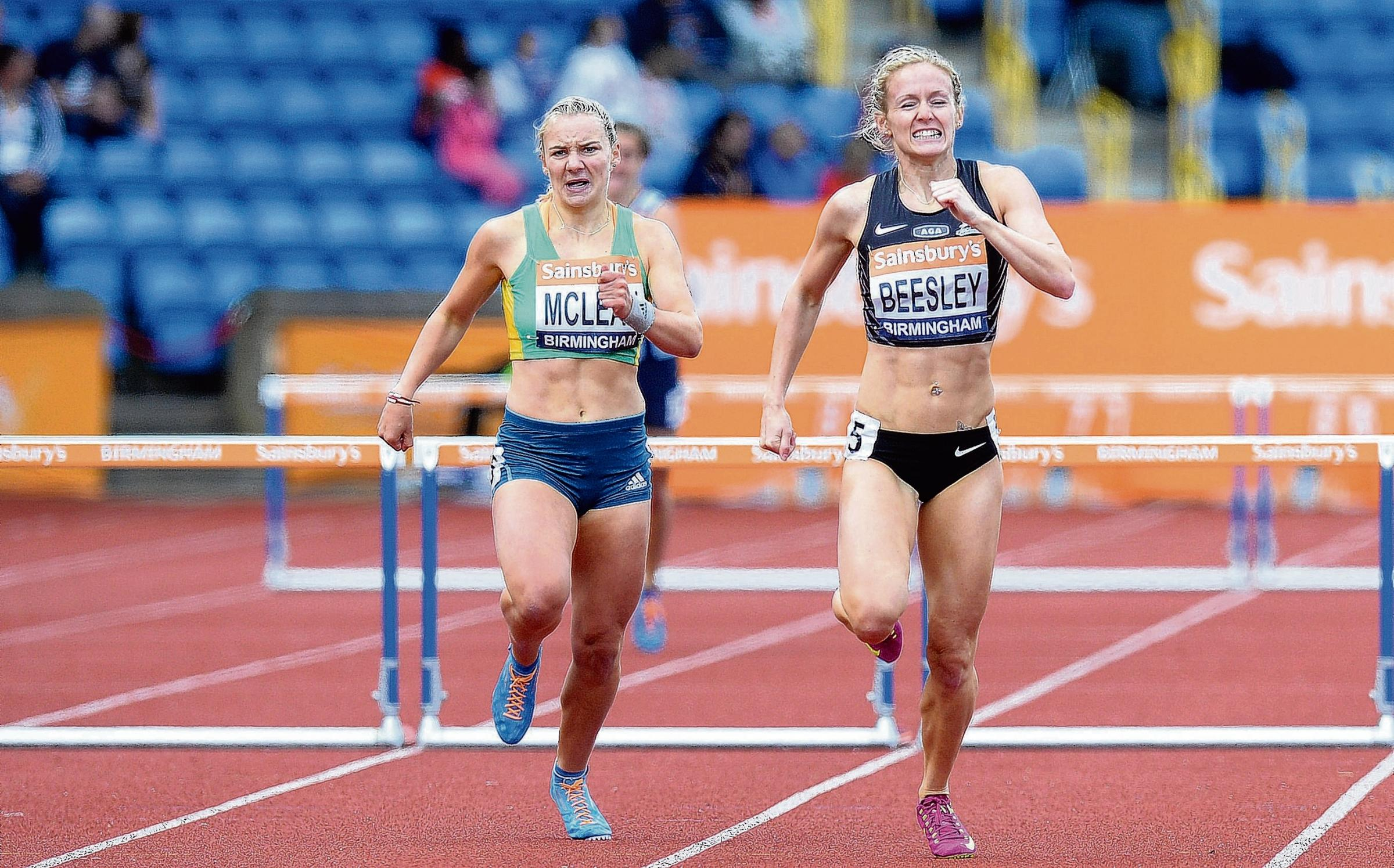 Hayley McLean battling with Meghan Beesley in the final 100m of the 400m hurdles final