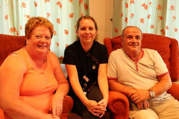 Volunteer therapists wanted - complementary therapy and wellbeing coordinator Lucie Cole with patient Stephen Hughes and his wife, Irene