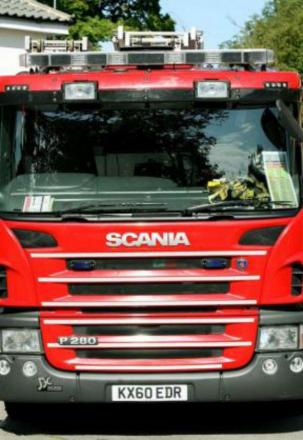 Vandals torch shed and close dual carriageway