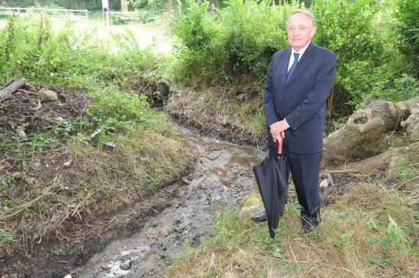 Keith Hudson by a dredged stream in Westminster Drive