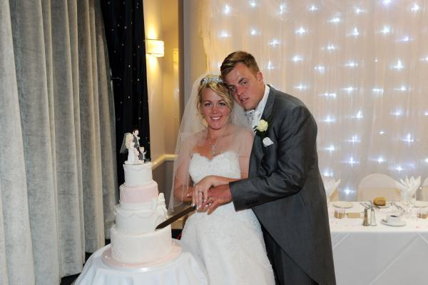 Unforgettable day – newlyweds Shane and Josephine cut their wedding cake
