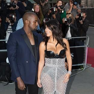 Kim Kardashian and Kanye West arrive at th