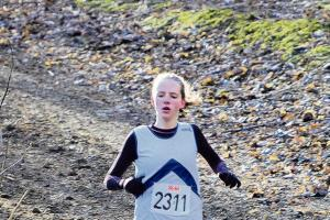 Gemma Holloway wins a bronze medal at the Southern Cross-Country Championships