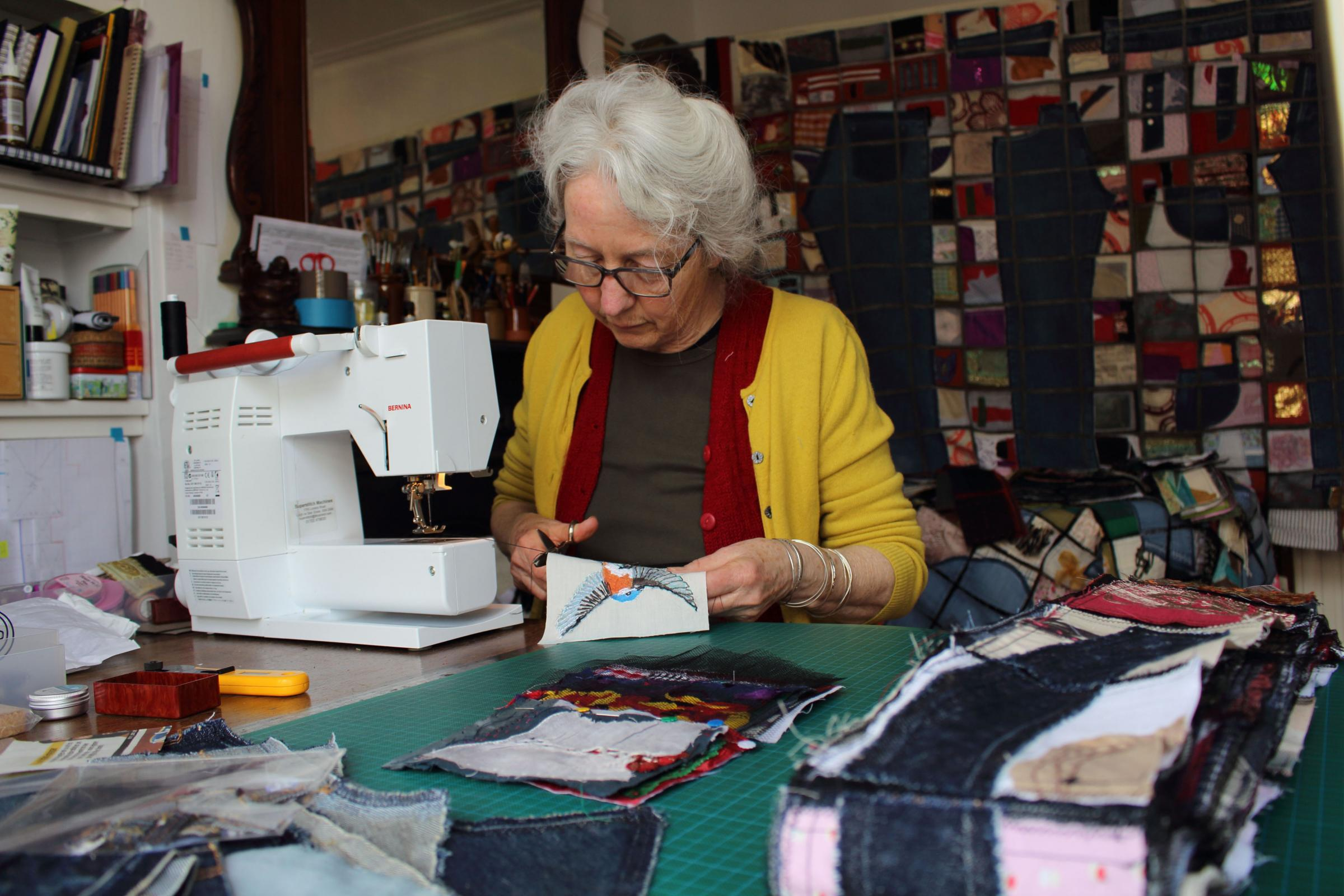 Gwen Simpson at her sewing maching - by Joe Scotland