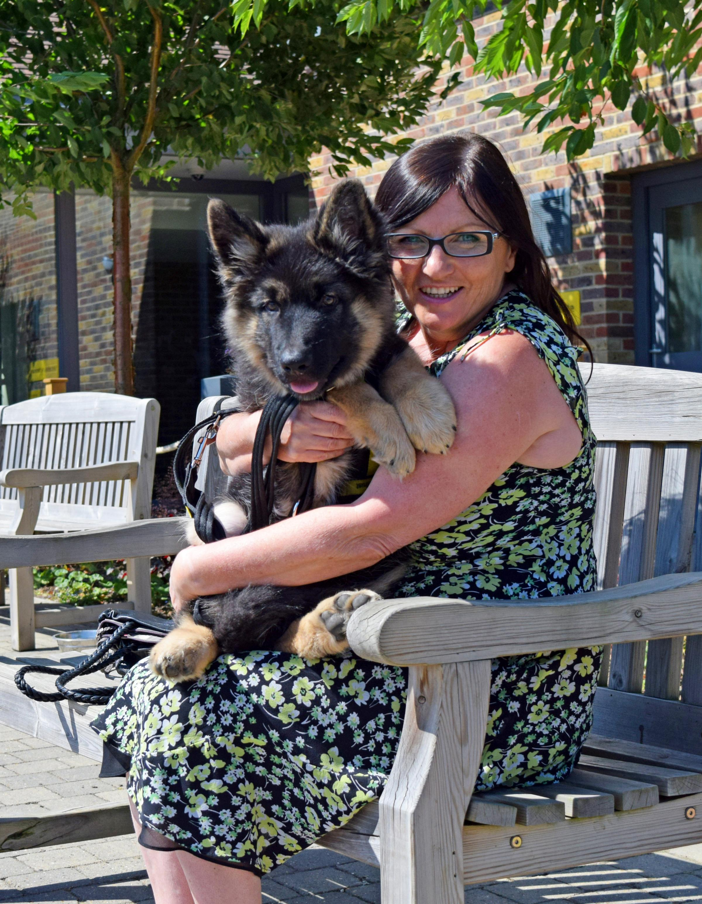 Sandy with Zorro the puppy who was abandoned with its umbilical cord still attached and was taken into a rescue centre by a member of the public who mistook it for a newborn FOX CUB. See SWNS story SWPUPPY. Staff at Dogs Trust were shocked when the one-da