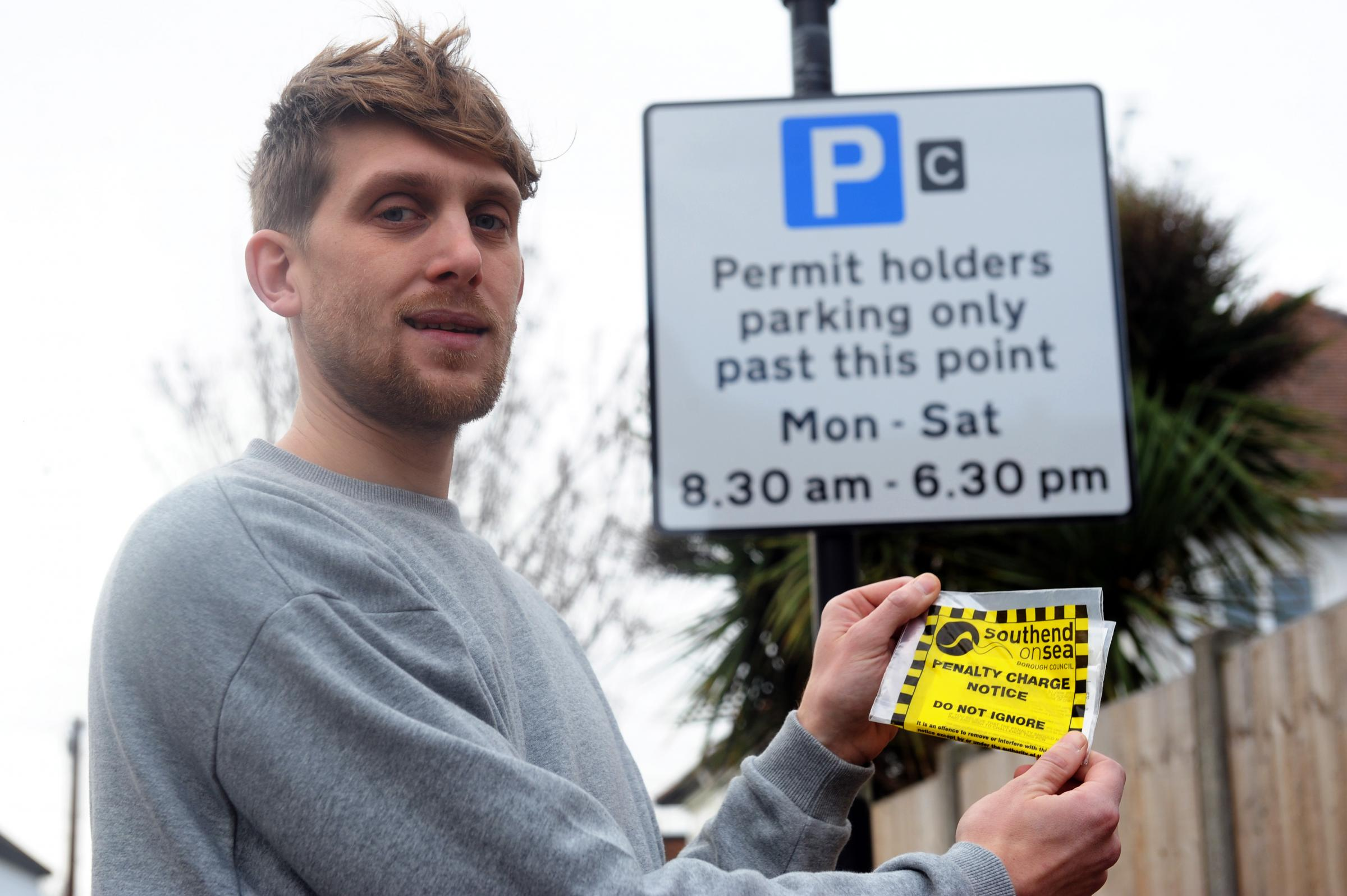 Angry - Scott Coltart with parking fine despite having a permit
