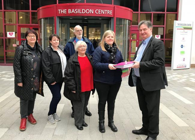 Petition - Members of the group calling for a Wickford Town Council to be formed handing their petition to Andrew Baggott