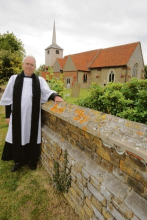Rev Nigel Ransom next to church wall at St Laurence Church